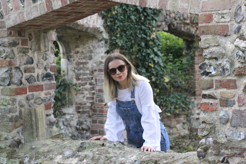 Dungarees and white blouse