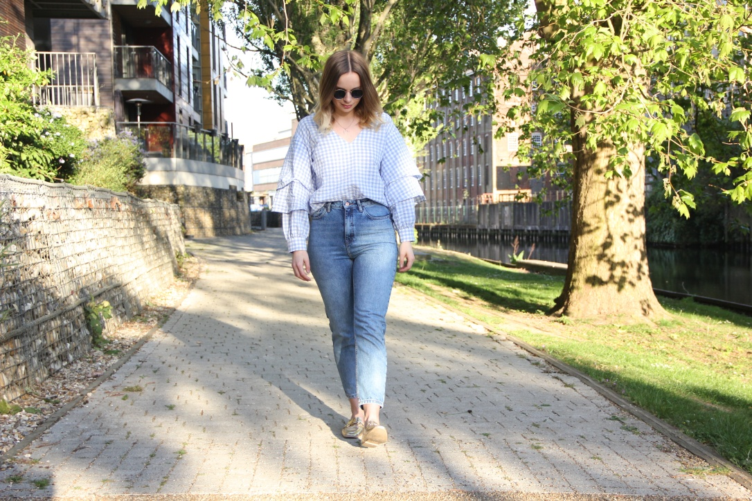 Gold loafers, gingham top and jeans