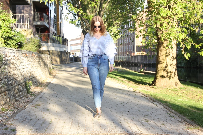 Jeans, gold loafers and gingham top