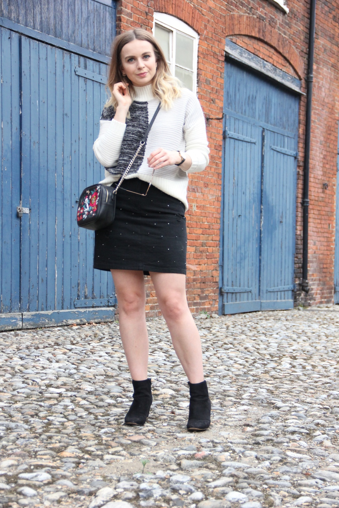 Colour block jumper and black denim skirt