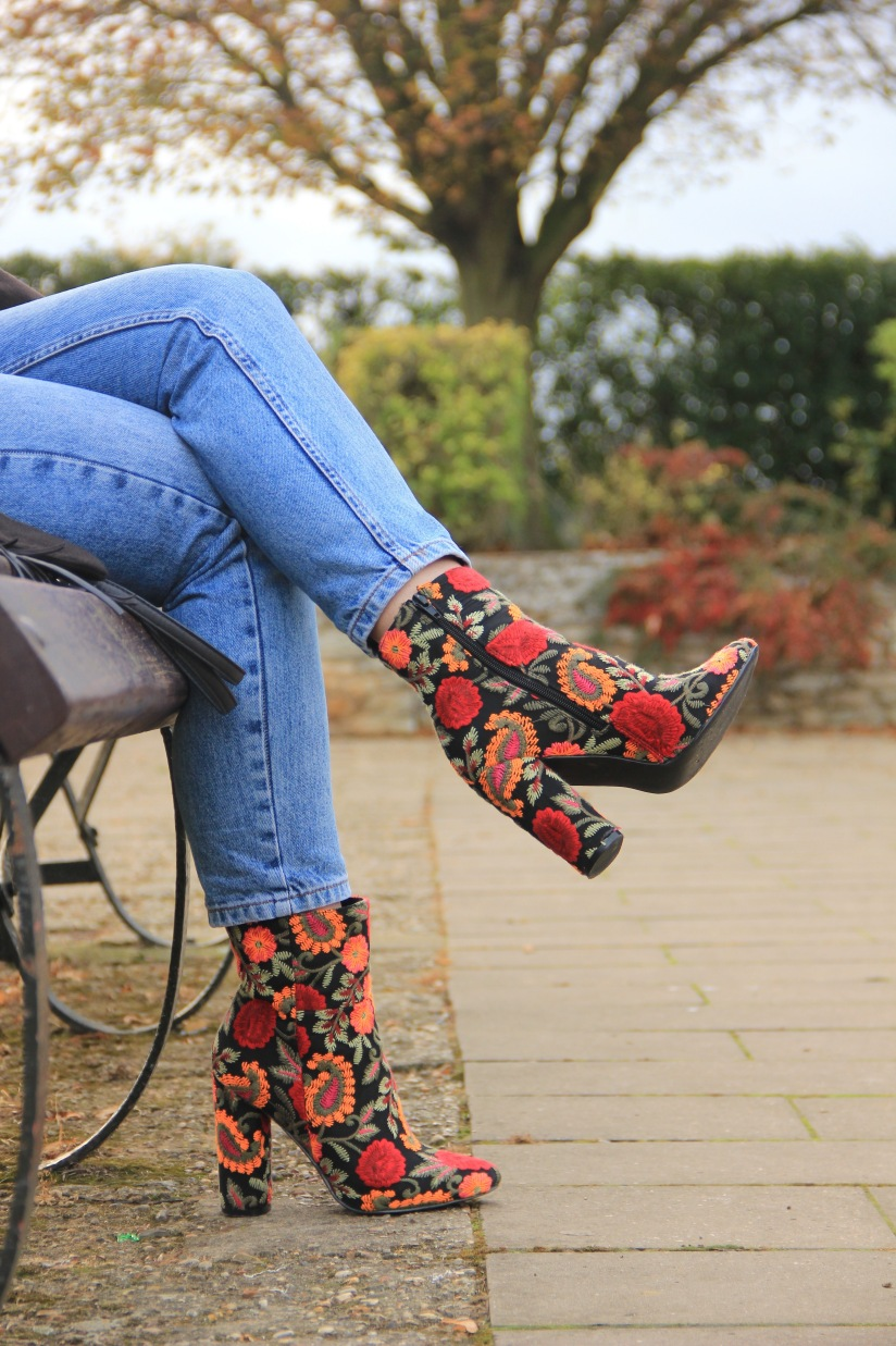 Embroidered boots and jeans
