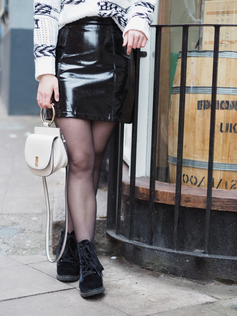 Vinyl skirt and biker boots outfit
