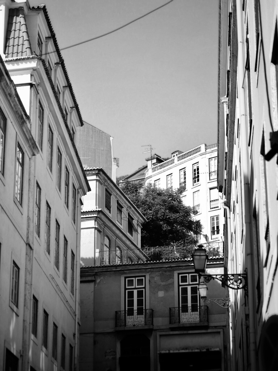 Black and white photo of street in Alfama, Lisbon