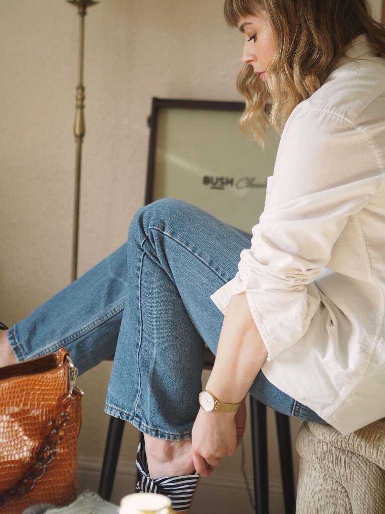 Elevated basics outfit - blue jeans, oversized white shirt and gold details